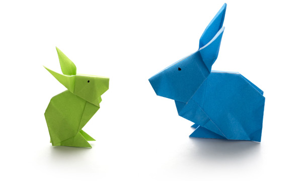 A green and a blue rabbit conversing